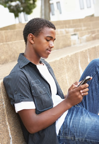 teen guy texting on phone