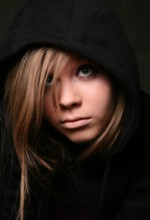 unhappy teenage girl wearing black hoodie