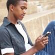 african american teen boy texting