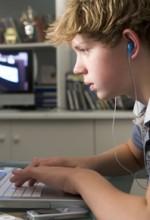 teen boy on computer