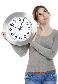 mom holding clock