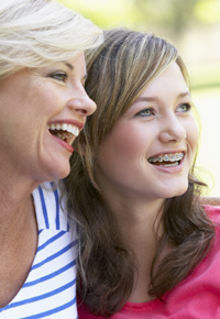 smiling mother with teenage daughter