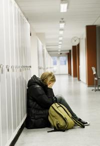 girl sad at school by lockers