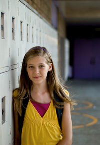 girl standing by lockers