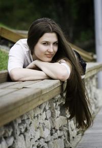 teen girl lying on stone wall