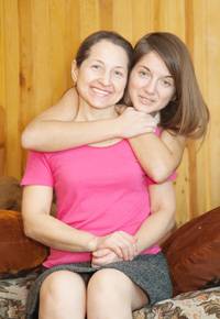 mother with daughter on couch