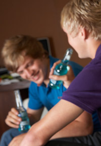 teen guys drinking alcoholic beverages