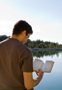 reading the bible by lake