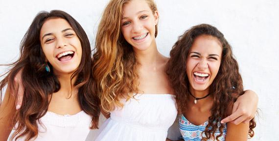 group of happy teenage girls